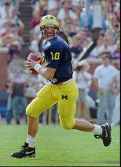 Michigan quarterback Todd Collins lost, 22-6, to Ohio State in 1994.