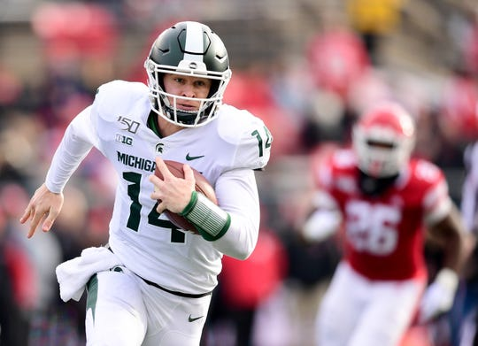 Michigan State's Brian Lewerke runs the ball during against Rutgers on Nov. 23, 2019 in Piscataway, N.J.