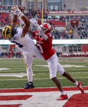 BLOOMINGTON, IN - NOVEMBER 23: Donovan Peoples-Jones #9 of the Michigan Wolverines goes up for a touchdown reception as Tiawan Mullen #3 of the Indiana Hoosiers defends during the first half at Memorial Stadium on November 23, 2019 in Bloomington, Indiana. (Photo by Michael Hickey/Getty Images)
