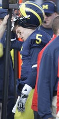 Michigan QB Tate Forcier hangs his head as he walks to the back of the bench after throwing the last of his four interceptions in their 21-10 loss to Ohio State in Ann Arbor on Nov. 21, 2009.