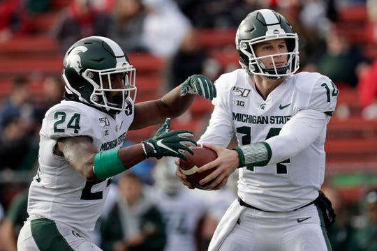 Mark Dantonio's decision to anoint Detroit U-D Jesuit product Elijah Collins (24) as Michigan State's starting running back was the coach's best move of the season.