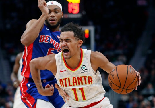 Hawks guard Trae Young drives on Pistons guard Bruce Brown during the second half.