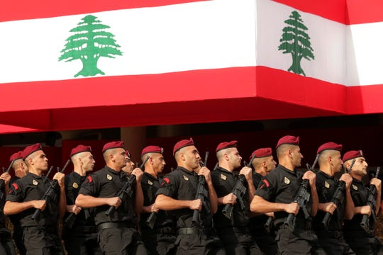 Lebanese marine special forces soldiers march during a military parade to mark the 76th anniversary of Lebanon's independence from France at the Lebanese Defense Ministry, in Yarzeh near Beirut, Lebanon, Friday, Nov. 22, 2019.