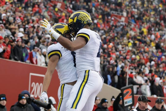 Michigan wide receiver Ronnie Bell (8) celebrates a touchdown reception with wide receiver Nico Collins (4) during the first half.