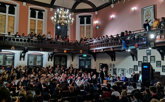 In this photo taken on Thursday, Nov. 21, 2019, audience members look on during a debate on the threat of artificial intelligence at the Cambridge Union, the world's oldest debating society, Cambridge, England.