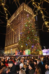The Michigan-grown, 60 foot tall Norway Spruce comes alive with 19,000 multi-colored led lights as the crowd cheers. 16th Annual Detroit Tree Lighting in Campus Martius Park in Detroit, Michigan on November 22, 2019.