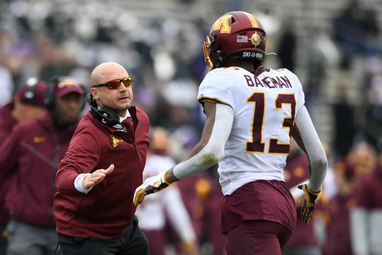 Minnesota coach P.J. Fleck left, celebrates with receiver Rashod Bateman (13) after Bateman caught a touchdown pass during the first half on Saturday.