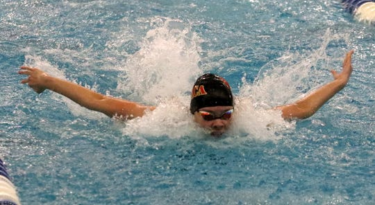 Ilah Jefferis swims the butterfly for Ithaca in the 200 medley relay during prelims at the New York State Girls Swimming and Diving Championships at Ithaca College.