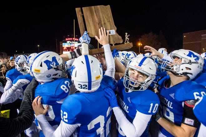The Memorial Tigers celebrate victory in the Class 4A semistate game against the Mt. Vernon Marauders 28-3 at Enlow Field in Evansville, Ind., Friday evening, Nov. 22, 2019.