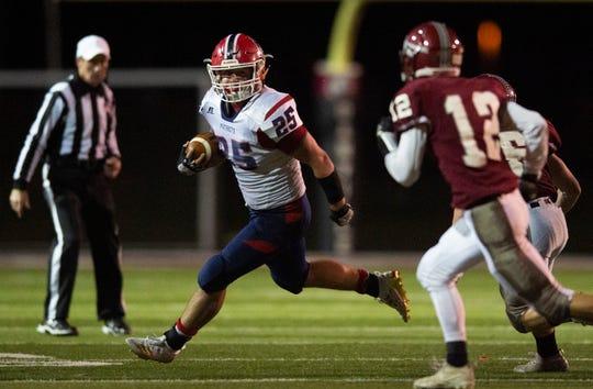 Heritage Hills' Jacob Wetzel (25) attempts to outrun Danville's defense at the Heritage Hills vs Danville semistate football game at in Danville High School, Danville, Ind., Friday, Nov. 22, 2019.