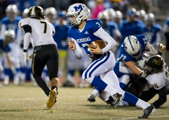 Memorial's Colton Pence (3) runs the ball during the Class 4A semistate game against the Mt. Vernon Marauders at Enlow Field in Evansville, Ind., Friday evening, Nov. 22, 2019.