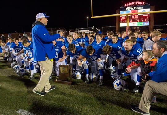 Memorial head coach John Hurley addresses his team after winning the Class 4A semistate game against the Mt. Vernon Marauders 28-3 at Enlow Field in Evansville, Ind., Friday evening, Nov. 22, 2019.