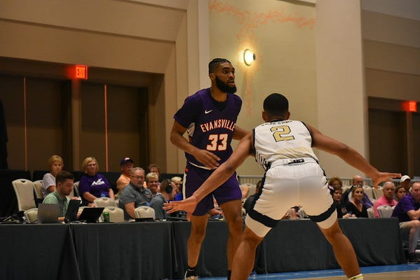 K.J. Riley dribbles during Evansville's game against George Washington on Saturday in the Islands of the Bahamas Showcase.