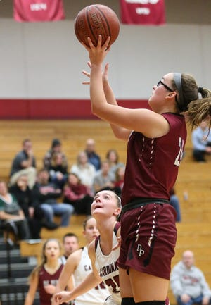 De Pere senior center Sophia McCarty, shown in a November 2019 game, has provided a veteran influence and ranks third on the team in scoring with 9.5 points per game.
