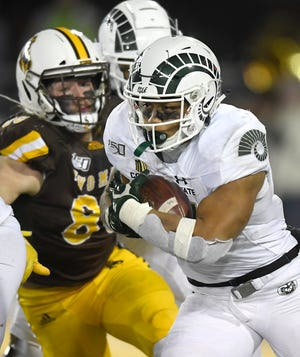 Colorado State Rams running back Jaylen Thomas (27) runs the ball up the field in the second quarter of the game at War Memorial Stadium at University of Wyoming in Laramie, Wyo. on Friday, Nov. 22, 2019.