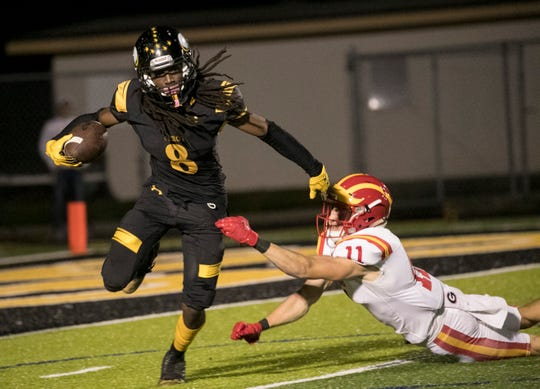 Malik Curtis of Bishop Verot slips past Caden Coletti of Clearwater Central Catholic in the Class 3A regional final game on Friday, Nov. 22, 2019, at Bishop Verot High School in Fort Myers.