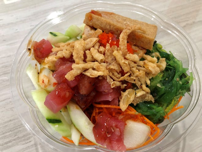 A build-your-own poke bowl ($9.99) with ahi and fried tofu from Premier Poke in south Fort Myers.