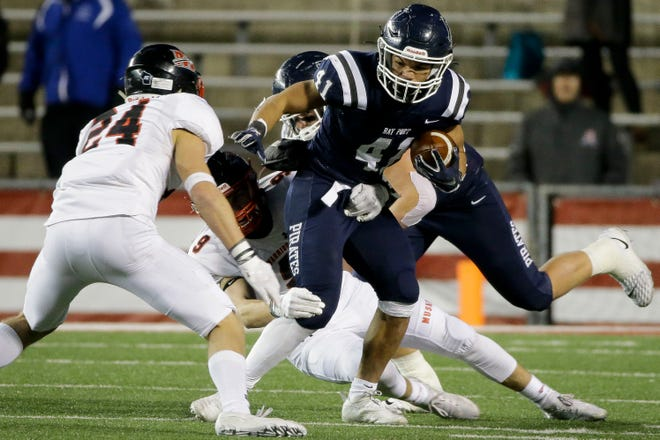 Bay Port's Isaiah Gash (41) runs the ball against Muskego in the WIAA Division 1 state championship game in November.