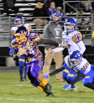 Logan Stuart of Suring escapes a Gibraltar tackle in their game on Sept. 6.