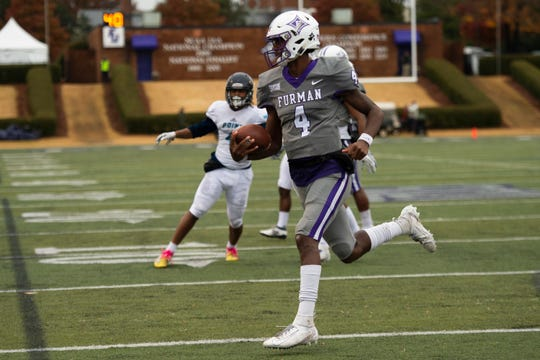 Furman quarterback Darren Grainger (4) scores the first touchdown in the game against Point University at Paladin Stadium Saturday, Nov. 23, 2019.