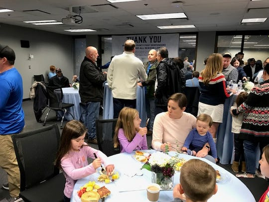 First responders and their families enjoy a breakfast hosted by Marci Wilhelm and Steve Rose to thank them for their efforts after a Sept. 27, 2018 plane crash. 11/23/19