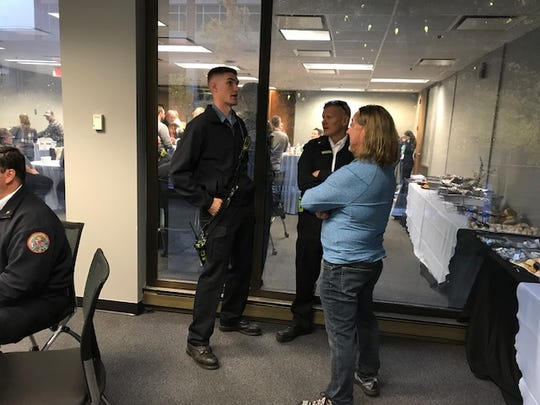 Steve Rose chats with first responders at a breakfast to thank them a year after they survived a plane crash in Greenville on Nov. 23.