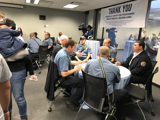 First responders enjoying a breakfast hosted by Marci Wilhelm and Steve Rose to thank them for saving their lives after a September 2018 plane crash. 11/23/19