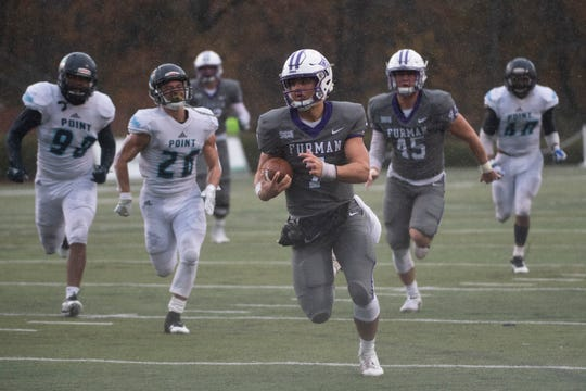 Furman quarterback Jack Hardin (7) carries the ball and scores a touchdown during the game against Point University at Paladin Stadium Saturday, Nov. 23, 2019.