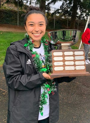 Guam's Skyylerblu Johnson poses with the Northwest Athletic Conference's Women's Soccer Championship trophy after her team, the Highline College Thunderbirds, won the 2019 conference title earlier this week.
