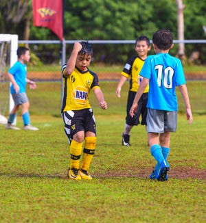 Napa Rovers-Yellow's Miguel Paxtian, 8, celebrates a little on the field after scoring a goal during the Triple J Auto Group Robbie Webber Youth League 2019 Fall Season Jamboree at the Guam Football Association National Training Center in Dededo on Saturday, Nov. 23, 2019.