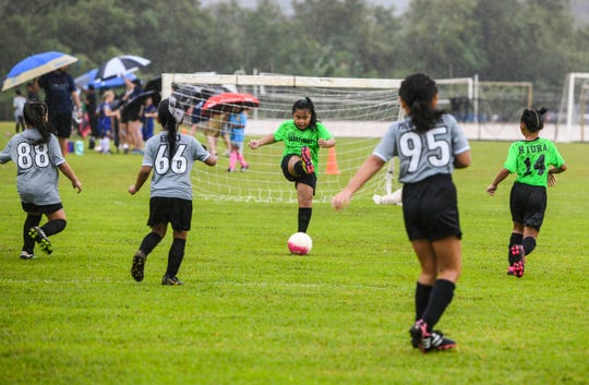 ASC Islanders' goalie Margret Gatbonton kicks the ball back into play in an Under-8 Division game at the Triple J Auto Group Robbie Webber Youth League 2019 Fall Season Jamboree at the Guam Football Association National Training Center in Dededo on Saturday, Nov. 23, 2019.