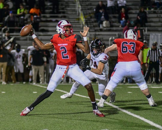 Petal Panthers quarterback Decarlos Nicholson looks to make a pass against the Brandon Bulldogs during the first half of their playoff game Nov. 22, 2019.