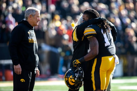 Iowa head coach Kirk Ferentz and his wife Mary Ferentz meet Iowa defensive back Devonte Young (17) at midfield before a NCAA Big Ten Conference football game, Saturday, Nov. 23, 2019, at Kinnick Stadium in Iowa City, Iowa.