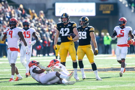 Iowa tight end Shaun Beyer (42) celebrates a first down with teammate Nate Wieting (39) during a NCAA Big Ten Conference football game, Saturday, Nov. 23, 2019, at Kinnick Stadium in Iowa City, Iowa.