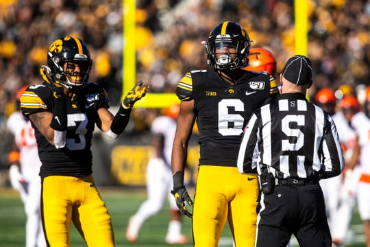 Iowa wide receiver Ihmir Smith-Marsette (6) reacts after pulling in a pass as teammate Tyrone Tracy, Jr. (3) celebrates during a NCAA Big Ten Conference football game, Saturday, Nov. 23, 2019, at Kinnick Stadium in Iowa City, Iowa.