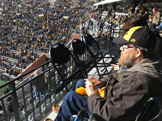 From his seat in the north end zone of Kinnick Stadium, Bob Wisecup takes in his first Iowa football game Saturday.