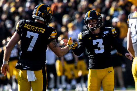 Iowa placekicker Keith Duncan, right, celebrates a successful field goal with holder Colten Rastetter during a NCAA Big Ten Conference football game, Saturday, Nov. 23, 2019, at Kinnick Stadium in Iowa City, Iowa.