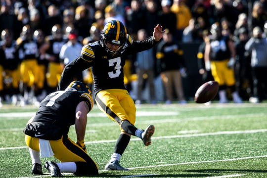 Iowa placekicker Keith Duncan (3) kicks a field goal with a hold from Colten Rastetter (7) during a NCAA Big Ten Conference football game, Saturday, Nov. 23, 2019, at Kinnick Stadium in Iowa City, Iowa.