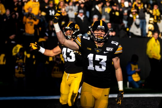 Iowa defensive end Joe Evans (13) and Iowa linebacker Dillon Doyle (43) pump up the crowd after a during a NCAA Big Ten Conference football game, Saturday, Nov. 23, 2019, at Kinnick Stadium in Iowa City, Iowa.