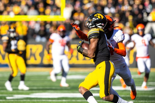 Iowa wide receiver Ihmir Smith-Marsette (6) pulls in a pass as Illinois defensive back Devon Witherspoon (31) defends during a NCAA Big Ten Conference football game, Saturday, Nov. 23, 2019, at Kinnick Stadium in Iowa City, Iowa.