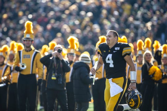 Nate Stanley comes onto the field for Iowa's senior-day game against Illinois, which became a 19-10 win. Stanley finished his career 16-5 in Kinnick as a starter, and takes a 26-12 career mark into the Holiday Bowl.