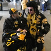 """Bob Wisecup gets a surprise visit from """"Hawkeye Elvis"""" before Saturday's Iowa football game at Kinnick Stadium. Wisecup is an avid fan of Elvis Presley, and once saw the singer perform at the old Veterans Auditorium in Des Moines."""