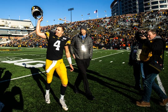 Nate Stanley salutes the Kinnick Stadium crowd after his 25th win as a Hawkeye starting quarterback.