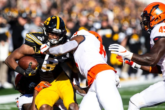 Ihmir Smith-Marsette, left, had a big game in the receiving department (four catches, 121 yards) but also took some punishing hits against Illinois in the Hawkeyes' 19-10 victory.