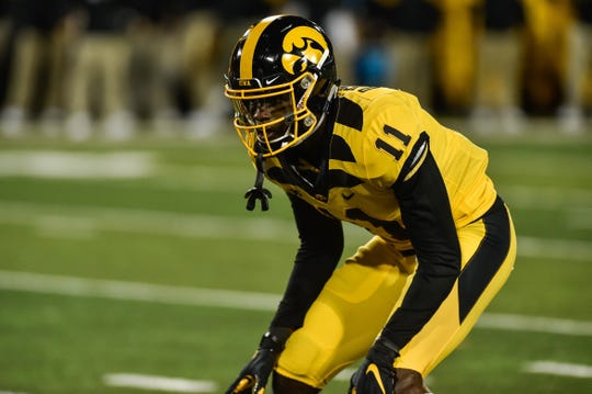 Iowa Hawkeyes defensive back Michael Ojemudia (11) in action against the Penn State Nittany Lions at Kinnick Stadium.