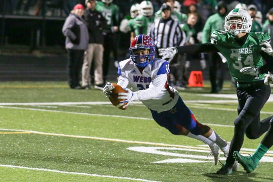 Western Boone's Cortez Stoudemire (33) lays out for a key fourth-down catch late in the first half that set up another Stars' touchdown.