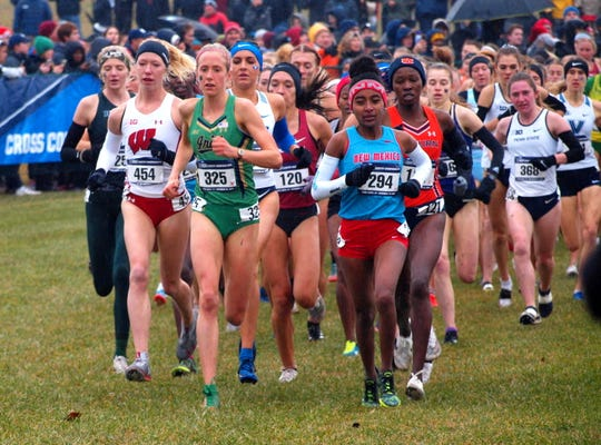 Notre Dame's Anna Rohrer (325) runs alongside eventual champion Weini Kelati (294) of New Mexico just past the mile mark at the NCAA Cross-Country Championships on Saturday at Terre Haute. Rohrer finished 17th.