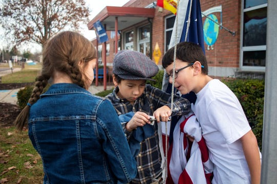The 4th grade students at Poston Road Elementary School in Martinsville, IN., prepare to hoist the U.S. flag.