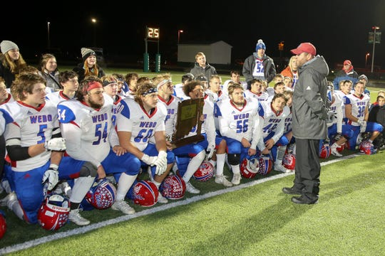 Western Boone Coach Justin Pelley talks to his team following their victory in the Triton Central vs Western Boone High School IHSAA Class 2A Semi-State   Championship football held at Triton Central High School, November 22, 2019.