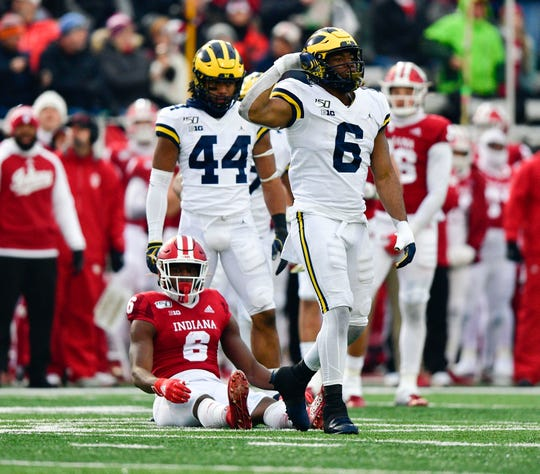Wolverines linebacker Josh Uche (6) celebrates tacking Indiana Hoosiers wide receiver Donavan Hale (6) during the first half of the game at Memorial Stadium.